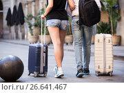 Купить «Energetic couple going the historic city center», фото № 26641467, снято 25 мая 2017 г. (c) Яков Филимонов / Фотобанк Лори