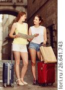 Купить «Smiling traveling women using paper map in town», фото № 26641743, снято 29 мая 2017 г. (c) Яков Филимонов / Фотобанк Лори