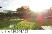 Купить «sun shining in summer garden with mown lawn», видеоролик № 26644155, снято 27 июня 2017 г. (c) Syda Productions / Фотобанк Лори