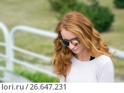 Model with the red hair in the sunglasses glasses. Стоковое фото, фотограф Вячеслав / Фотобанк Лори