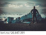 Купить «Man explorer lookig at Jokulsarlon lagoon, Iceland.», фото № 26647391, снято 21 марта 2019 г. (c) Andrejs Pidjass / Фотобанк Лори