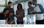 Купить «Colleagues using digital tablet and mobile phone», видеоролик № 26647659, снято 24 января 2020 г. (c) Wavebreak Media / Фотобанк Лори