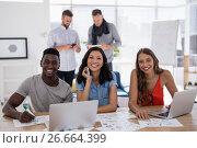 Купить «Young business colleagues working on laptop in the office», фото № 26664399, снято 26 марта 2017 г. (c) Wavebreak Media / Фотобанк Лори