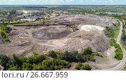 Купить «View of site for processing blast furnace slag from the NLMK plant», фото № 26667959, снято 11 июля 2017 г. (c) Володина Ольга / Фотобанк Лори