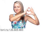 Купить «pretty young woman making heart sign on white», фото № 26669483, снято 22 января 2012 г. (c) Tatjana Romanova / Фотобанк Лори