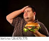 Fat man eating fast food hamberger. Breakfast for overweight person. Стоковое фото, фотограф Gennadiy Poznyakov / Фотобанк Лори
