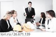 Купить «building chief speech at meeting in office», фото № 26671139, снято 25 апреля 2018 г. (c) Татьяна Яцевич / Фотобанк Лори