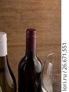 Купить «Cropped image of wineglass by bottles», фото № 26671551, снято 15 февраля 2017 г. (c) Wavebreak Media / Фотобанк Лори