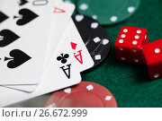 Купить «Playing cards, dices and casino chips on poker table», фото № 26672999, снято 6 апреля 2017 г. (c) Wavebreak Media / Фотобанк Лори