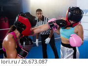 Купить «Male referee looking at female boxer punching competitor», фото № 26673087, снято 22 января 2017 г. (c) Wavebreak Media / Фотобанк Лори