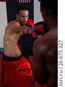 Купить «Trainer assisting man in boxing», фото № 26673327, снято 22 января 2017 г. (c) Wavebreak Media / Фотобанк Лори