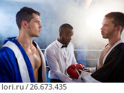 Купить «Referee checking gloves of male boxer», фото № 26673435, снято 22 января 2017 г. (c) Wavebreak Media / Фотобанк Лори