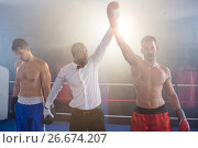 Купить «Referee lighting hand of winner in boxing ring», фото № 26674207, снято 22 января 2017 г. (c) Wavebreak Media / Фотобанк Лори