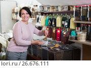 Купить «Mature brunette woman choosing tea», фото № 26676111, снято 22 июля 2018 г. (c) Яков Филимонов / Фотобанк Лори