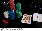 Купить «High angle view of cards and chips with dices», фото № 26676995, снято 6 апреля 2017 г. (c) Wavebreak Media / Фотобанк Лори