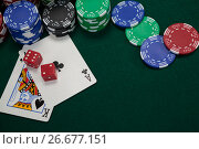 Купить «Playing cards, dices and casino chips on poker table», фото № 26677151, снято 6 апреля 2017 г. (c) Wavebreak Media / Фотобанк Лори
