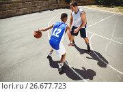 Купить «Basketball players playing in court», фото № 26677723, снято 18 февраля 2017 г. (c) Wavebreak Media / Фотобанк Лори