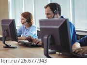 Купить «Business people working on computer at call center», фото № 26677943, снято 5 марта 2017 г. (c) Wavebreak Media / Фотобанк Лори