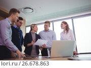 Купить «Classy business colleagues discussing around desk», фото № 26678863, снято 5 марта 2017 г. (c) Wavebreak Media / Фотобанк Лори