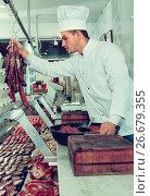 Купить «Professional cook sniffing freshly cooked dish», фото № 26679355, снято 18 сентября 2018 г. (c) Яков Филимонов / Фотобанк Лори
