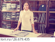 Купить «happy female seller demonstrating shirts in men's cloths store», фото № 26679435, снято 16 октября 2018 г. (c) Яков Филимонов / Фотобанк Лори