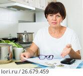 Купить «stressful woman paying bills», фото № 26679459, снято 17 июля 2018 г. (c) Яков Филимонов / Фотобанк Лори