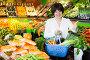 Middle aged woman with basket choosing vegetables, фото № 26679607, снято 10 марта 2017 г. (c) Яков Филимонов / Фотобанк Лори