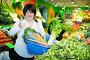 Middle aged woman with basket choosing vegetables, фото № 26679611, снято 10 марта 2017 г. (c) Яков Филимонов / Фотобанк Лори