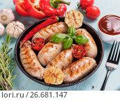 Купить «Grilled chicken sausages top view», фото № 26681147, снято 18 июля 2017 г. (c) Ольга Сергеева / Фотобанк Лори