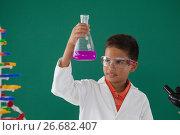 Купить «Attentive schoolboy doing a chemical experiment in laboratory», фото № 26682407, снято 5 апреля 2017 г. (c) Wavebreak Media / Фотобанк Лори