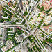 Aerial city view with crossroads and roads, houses, buildings, parks and parking lots. Sunny summer panoramic image, фото № 26689435, снято 25 июля 2017 г. (c) Александр Маркин / Фотобанк Лори