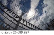 Купить «Prison. Typical landscape of the prison. Russian Penal System.», видеоролик № 26689927, снято 22 июля 2017 г. (c) Mikhail Erguine / Фотобанк Лори