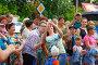 Девушки делают селфи в толпе людей, фото № 26690763, снято 23 июля 2017 г. (c) Иван Карпов / Фотобанк Лори