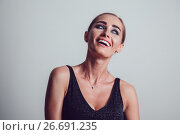Купить «Beautiful woman in black night fashion dress posing on a gray background.», фото № 26691235, снято 15 июля 2017 г. (c) Женя Канашкин / Фотобанк Лори