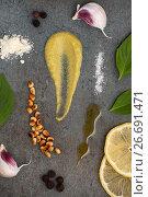 Купить «Продуктовый набор для приготовления соуса Песто на каменном сером фоне», фото № 26691471, снято 26 июня 2019 г. (c) Olesya Tseytlin / Фотобанк Лори