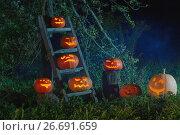Купить «Halloween Jack-o-Lantern pumpkins outdoor», фото № 26691659, снято 30 сентября 2016 г. (c) Майя Крученкова / Фотобанк Лори