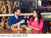 Купить «happy couple dining and drink wine at restaurant», фото № 26692575, снято 8 ноября 2015 г. (c) Syda Productions / Фотобанк Лори