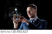 Купить «businessman with smartphone and virtual holograms», фото № 26692627, снято 9 марта 2017 г. (c) Syda Productions / Фотобанк Лори
