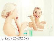 Купить «woman with makeup brush and powder at bathroom», фото № 26692675, снято 13 февраля 2016 г. (c) Syda Productions / Фотобанк Лори