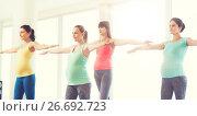 Купить «happy pregnant women exercising in gym», фото № 26692723, снято 5 марта 2016 г. (c) Syda Productions / Фотобанк Лори