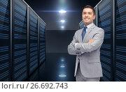 Купить «smiling businessman over server room background», фото № 26692743, снято 29 января 2015 г. (c) Syda Productions / Фотобанк Лори