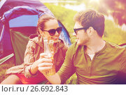Купить «happy couple clinking drinks at campsite tent», фото № 26692843, снято 27 мая 2016 г. (c) Syda Productions / Фотобанк Лори