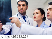 Купить «group of medics with spine x-ray scan at hospital», фото № 26693259, снято 3 декабря 2015 г. (c) Syda Productions / Фотобанк Лори