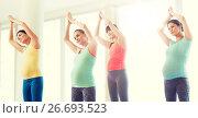 Купить «happy pregnant women exercising in gym», фото № 26693523, снято 5 марта 2016 г. (c) Syda Productions / Фотобанк Лори