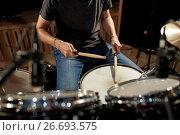 Купить «man playing drums at concert or music studio», фото № 26693575, снято 18 августа 2016 г. (c) Syda Productions / Фотобанк Лори