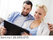 Купить «smiling happy couple with tablet pc at home», фото № 26693615, снято 11 февраля 2017 г. (c) Syda Productions / Фотобанк Лори