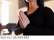 Купить «close up of sad woman praying god in church», фото № 26693683, снято 20 марта 2017 г. (c) Syda Productions / Фотобанк Лори