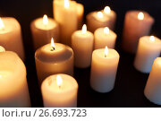 Купить «candles burning in darkness over black background», фото № 26693723, снято 20 марта 2017 г. (c) Syda Productions / Фотобанк Лори