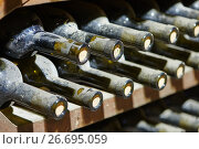 Купить «stacked old wine bottles in wine cellar», фото № 26695059, снято 22 сентября 2015 г. (c) Дмитрий Калиновский / Фотобанк Лори