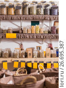 Купить «large glass bottle with many different dried herbs standing in biofood store», фото № 26695387, снято 13 июня 2017 г. (c) Яков Филимонов / Фотобанк Лори